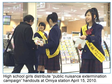 High school girls hand out anti-groper information at a train station in Japan
