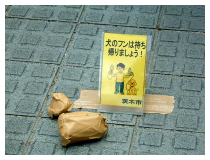 Yellow cards for dog feces collection in Japan