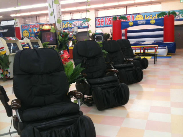 Massage chairs at a US Land amusement game center arcade in Japan