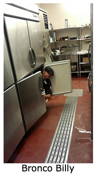 Part-time employee at a steak restaurant in Japan poses for photos in small refrigerator in kitchen