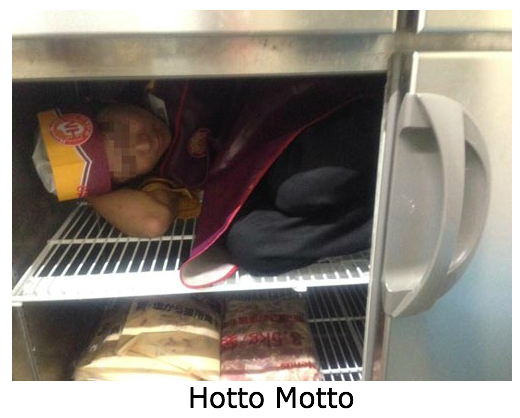 Part-time employee at a fast-food take out restaurant in Japan poses inside refrigerator