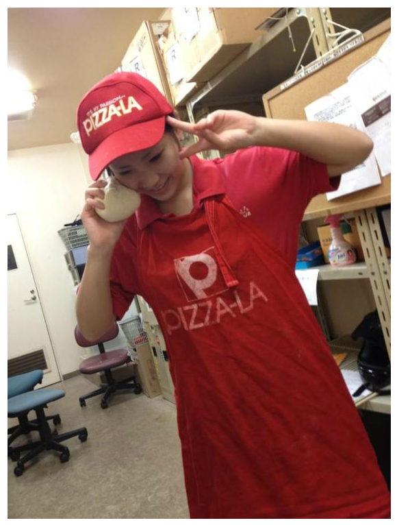 Part-time employee at a Pizza-la in Japan talks to pizza dough telephone