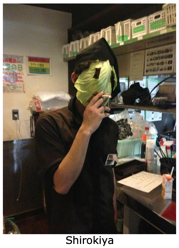 Part timer puts cabbage leaf on face at ramen restaurant in Japan