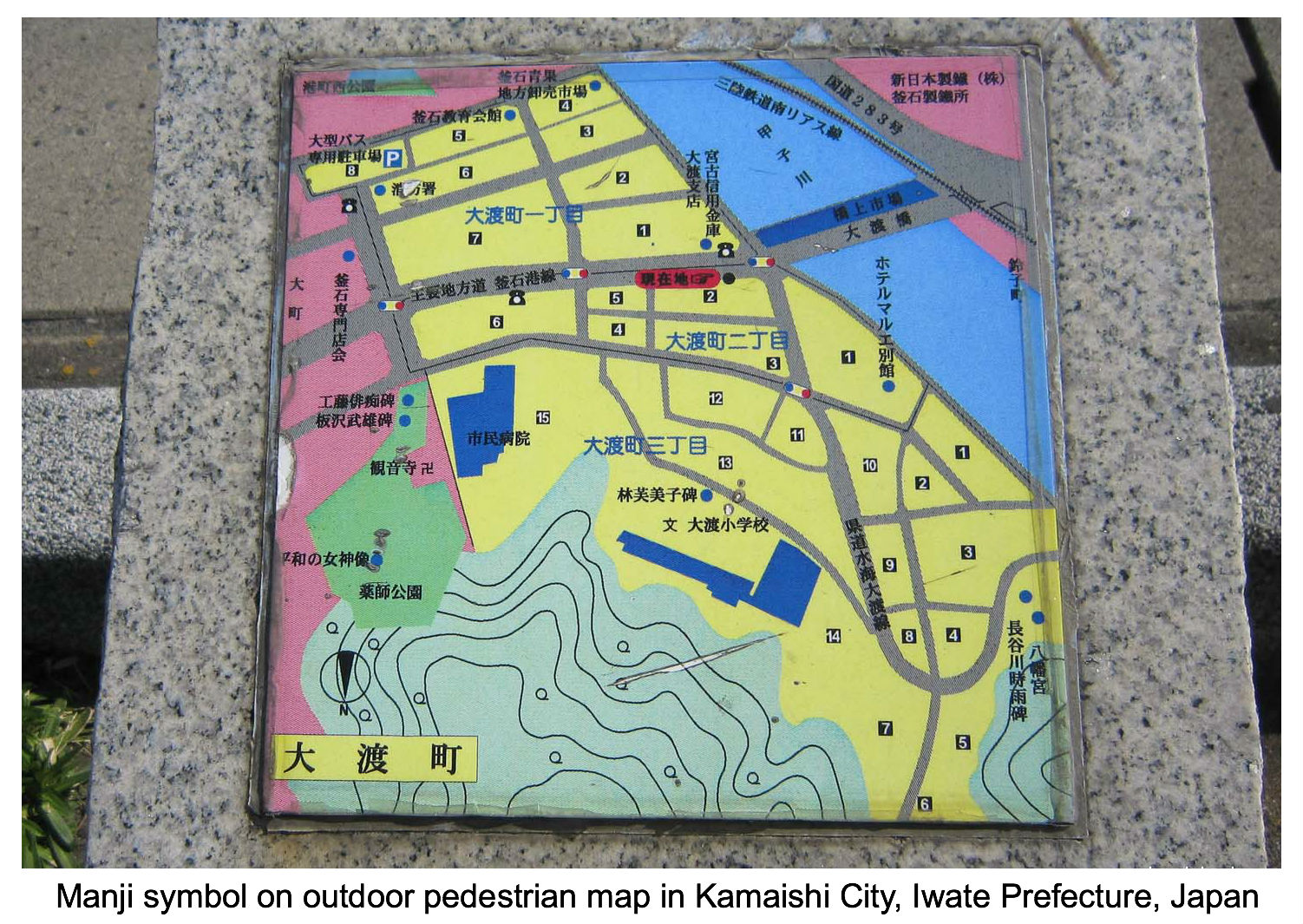 Swastika icon indicates temple on local map in Japan