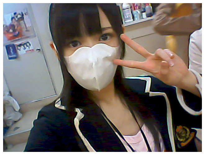 Japanese idol wears face mask to fight flu and allergies.