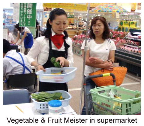Vegetable and fruit meister works in supermarket Japan