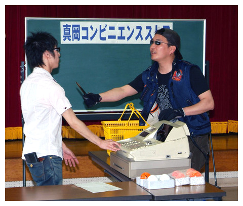 Convenience store clerks in Japan being trained with blackboard.