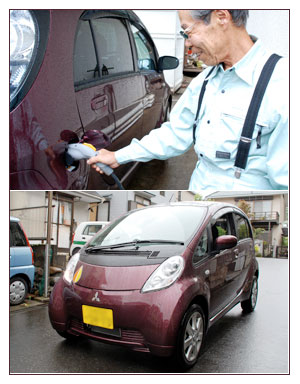 Elderly owner of Mitsubishi Japanese electric car imiev in Japan