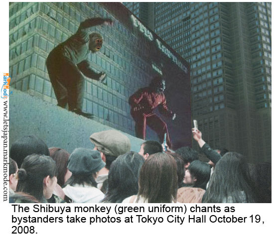 Japanese pedestrians take pictures of rioting monkeys at Tokyo metropolitan government building in Shinjuku.