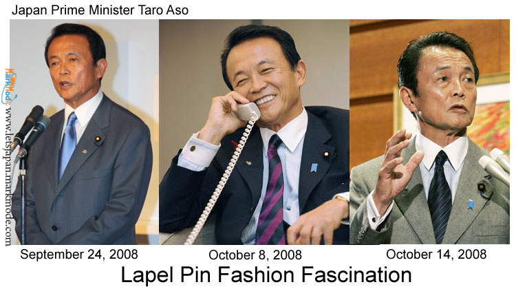 Japan Prime Minister Taro Aso wears member pins and badges.